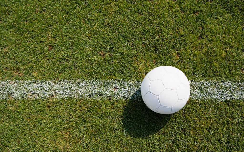 Football on pitch --- Image by © Image Source/Corbis